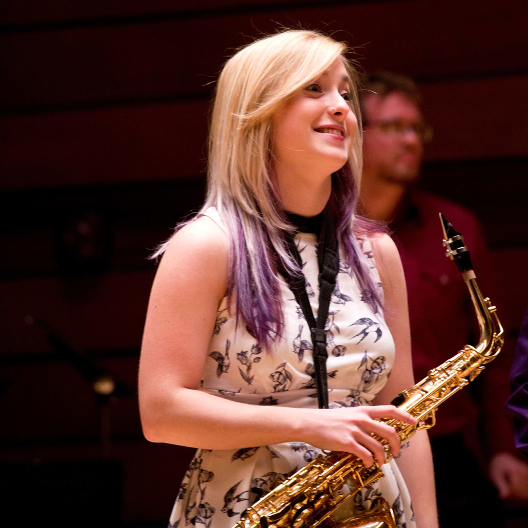 Saxophone player smiling during a performance at SOU Recital Hall