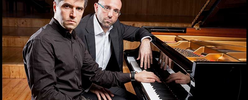 Sergio and Marco Sitting next to a piano