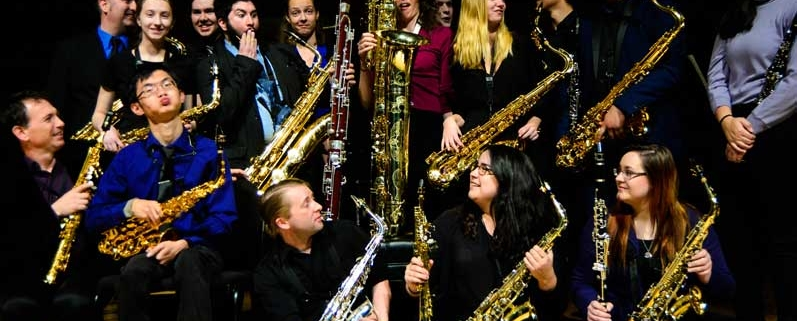 Photo of Members of the Siskiyou Saxophone Ensemble with instruments for in the mood concert